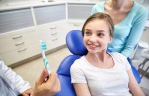 Children sitting on dental chair